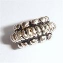 Zilveren kraal met spiraal in het midden en nopjes, antiek