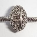 Zilveren kraal in de vorm van een discus