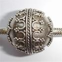 Zilveren kraal met krullen, nopjes en grote puntjes