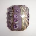Focal in paars/roze gestreept, zilverig bruin en stippen