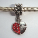 Pendant heart with red zirconia's and key hole