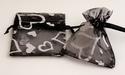 Organza cadeauzakje zwart met zilveren hartjes